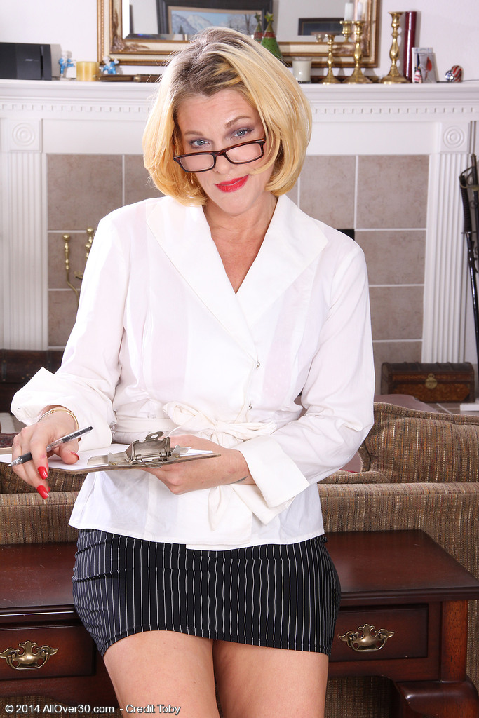 Hot  Blond Haired Secretary Courtney Smith Opens Her Haunches on Her Behalf Desk