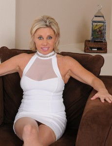 Hot Elegant 53 Year Old Blond Payton Hall Stretching Wide on the Chair